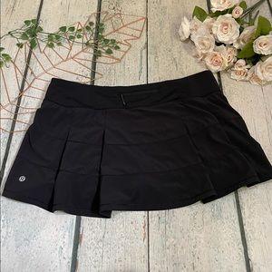 Lululemon 12 pace rival skirt black ruffle flare shorts running yoga activewear